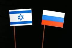 Bandeira israelita com a bandeira do russo no preto Fotografia de Stock