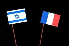 Bandeira israelita com a bandeira francesa no preto Foto de Stock