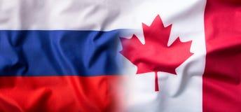 Bandeira misturada de Rússia e de Canadá Bandeira de Rússia e bandeira de Canadá imagem de stock