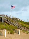 Bandeira na praia Imagens de Stock Royalty Free