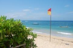 Bandeira na praia em Bali Fotos de Stock Royalty Free