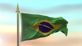 Bandeira nacional de Brasil que acena no vento contra o movimento lento do fundo do céu do por do sol vídeos de arquivo