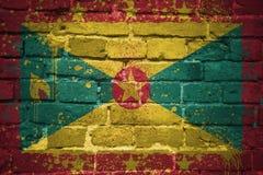 Bandeira nacional pintada de grenada em uma parede de tijolo Imagem de Stock Royalty Free