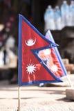 Bandeira nacional triangular de Nepal Fotografia de Stock