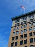 Bandeira no edifício Foto de Stock Royalty Free