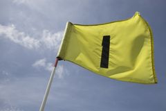 Bandeira no primeiro furo Imagens de Stock