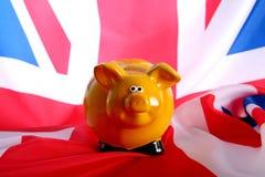 Bandeira Reino Unido com banco piggy Fotografia de Stock