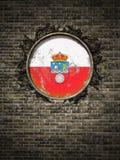 Bandeira velha de Cantábria na parede de tijolo Imagens de Stock