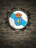Bandeira velha de Galiza na parede de tijolo Imagem de Stock