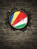 Bandeira velha de Seychelles na parede de tijolo Imagem de Stock Royalty Free