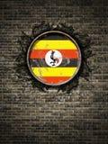 Bandeira velha de Uganda na parede de tijolo Imagem de Stock Royalty Free