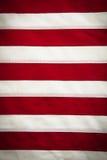 A bandeira, vermelho americanos e branco listram o fundo Foto de Stock Royalty Free