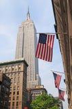 Bandeiras americanas e fundo do estado do império Fotografia de Stock Royalty Free