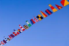 Bandeiras através do céu Foto de Stock Royalty Free