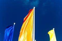 Bandeiras coloridas contra o céu azul Imagem de Stock Royalty Free