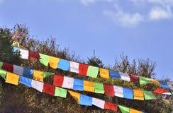 Bandeiras coloridas da oração da fileira Triplex Imagem de Stock Royalty Free