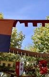 Bandeiras coloridas que penduram na rua fotos de stock royalty free