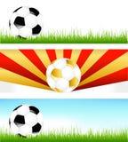 Bandeiras com esferas de futebol Fotos de Stock Royalty Free
