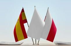 Bandeiras da Espanha e do Polônia fotografia de stock royalty free
