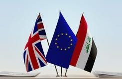 Bandeiras da UE de Grâ Bretanha e do Iraque fotos de stock