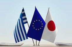 Bandeiras da UE de Grécia e do Japão foto de stock