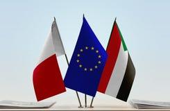 Bandeiras da UE de Malta e do Sudão fotografia de stock