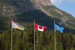 Bandeiras de Alberta, de Canadá e de Columbia Britânica fotografia de stock royalty free