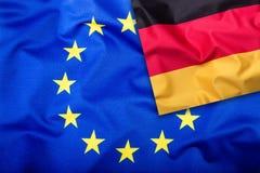 Bandeiras de Alemanha e da União Europeia Bandeira de Alemanha e bandeira da UE Bandeira dentro das estrelas Conceito da bandeira Fotografia de Stock
