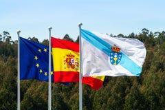 Bandeiras de Glaicia, de Espanha e de Europa que acenam sobre imagem de stock royalty free