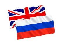 Bandeiras de Grâ Bretanha e de Rússia Fotografia de Stock