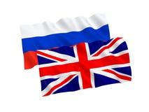 Bandeiras de Grâ Bretanha e de Rússia Foto de Stock