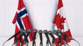 Bandeiras de Noruega e de Canadá na reunião ou na conferência internacional rendição 3d Imagens de Stock Royalty Free