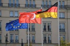 Bandeiras de ondulação Alemanha, peru e União Europeia foto de stock royalty free