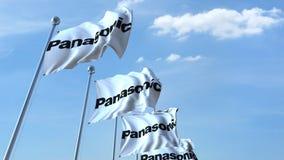 Bandeiras de ondulação com logotipo de Panasonic contra o céu, rendição 3D editorial Imagens de Stock