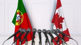 Bandeiras de Portugal e de Canadá na reunião ou na conferência internacional rendição 3d Imagens de Stock Royalty Free
