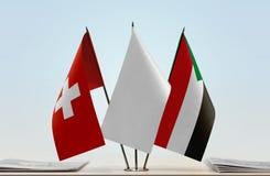 Bandeiras de Suíça e de Sudão fotografia de stock royalty free