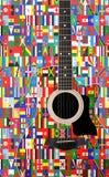 Bandeiras do mundo na guitarra acústica fotografia de stock royalty free