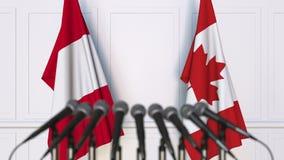 Bandeiras do Peru e do Canadá na reunião ou na conferência internacional rendição 3d Imagens de Stock