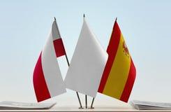 Bandeiras do Polônia e da Espanha fotografia de stock royalty free