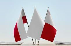 Bandeiras do Polônia e do Malta fotografia de stock