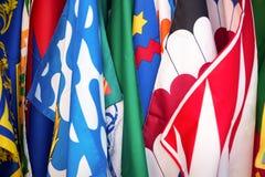 Bandeiras dos distritos do contrade de Siena, fundo do festival de Palio, em Siena, Toscânia Itália foto de stock royalty free