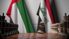 Bandeiras dos Emirados Árabes Unidos e do Iraque atrás de peões no tabuleiro de xadrez Jogo de xadrez ou rivalidade política rela ilustração do vetor