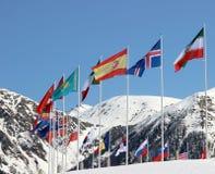 Bandeiras em um fundo das montanhas Fotos de Stock Royalty Free