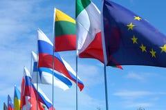 Bandeiras em um polo fotos de stock