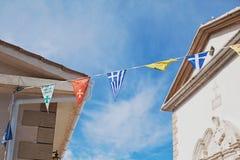 Bandeiras em uma vila grega Fotografia de Stock Royalty Free
