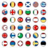 Bandeiras estilizados em tampões da cerveja Fotografia de Stock