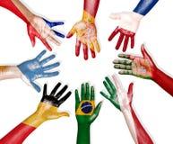 Bandeiras multinacionais tiradas nas mãos Fotografia de Stock