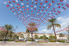 Bandeiras nacionais omanenses em Muttrah, Omã Imagem de Stock