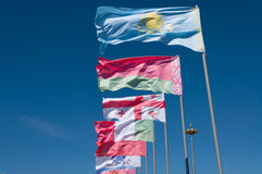 Bandeiras no fundo azul fotografia de stock royalty free