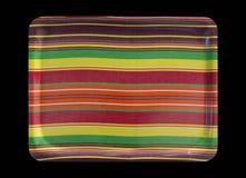 Bandeja colorida aislada en negro Imagenes de archivo